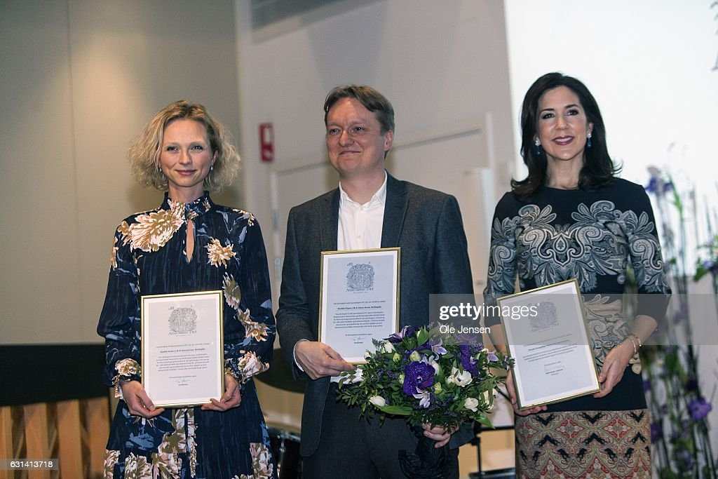 Crown Princess Mary (R) with her Honorary Award given for her work with social vulnerable groups, and journalists Simon Kruse (C) and Mathilde Kimer, who were both awarded for their coverage of the Ukrainian war at The Berlingske Media house on January 10, 2017 in Copenhagen, Denmark. Berlingske is one of the largest Danish media groups (2 news papers and other print media).