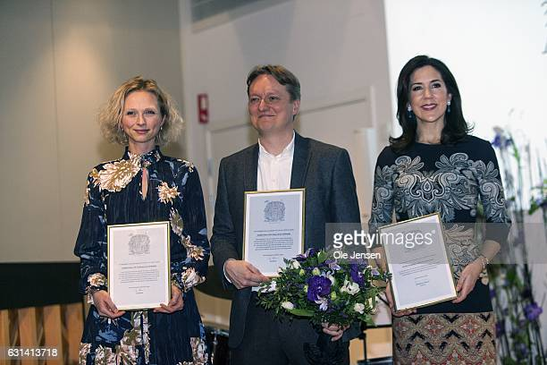 Crown Princess Mary with her Honorary Award given for her work with social vulnerable groups and journalists Simon Kruse and Mathilde Kimer who were...