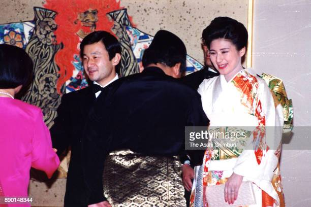 Crown Princess Masako and Crown Prince Naruhito welcome guests prior to the 'Kyuchu KyoennoGi' wedding dinner at the Imperial Palace on June 17 1993...