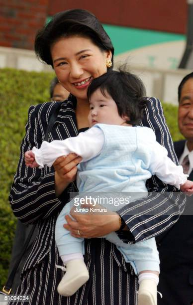 Crown Princess Masako And Her Daughter Aiko Arrive At Nasu Station After A WeekLong Vacation At An Imperial Villa May 14 2002 In Tochigi Prefecture...