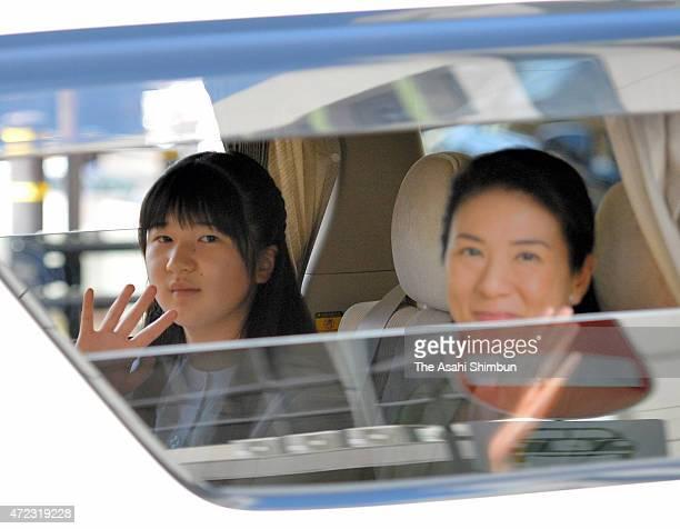 Crown Princess Masako and Princess Aiko wave to wellwishers on departure at JR Utsunommiya Station on May 3 2015 in Utsunomiya Tochigi Japan They...