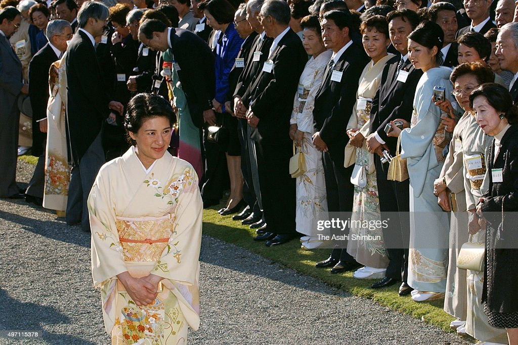 <a gi-track='captionPersonalityLinkClicked' href=/galleries/search?phrase=Crown+Princess+Masako&family=editorial&specificpeople=580174 ng-click='$event.stopPropagation()'>Crown Princess Masako</a> attends the autumn garden party at the Akasaka Imperial Garden on October 30, 2003 in Tokyo, Japan.