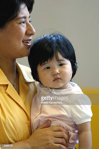 Crown Princess Masako holds her daughter Princess Aiko while standing in Tokyo station September 5 2002 in Tokyo Japan The Japanese royal family is...