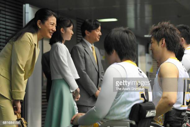 Crown Princess Masako Princess Aiko and Crown Prince Naruhito talk with players at a wheelchair basketball match at the Tokyo Metropolitan Gymnasium...