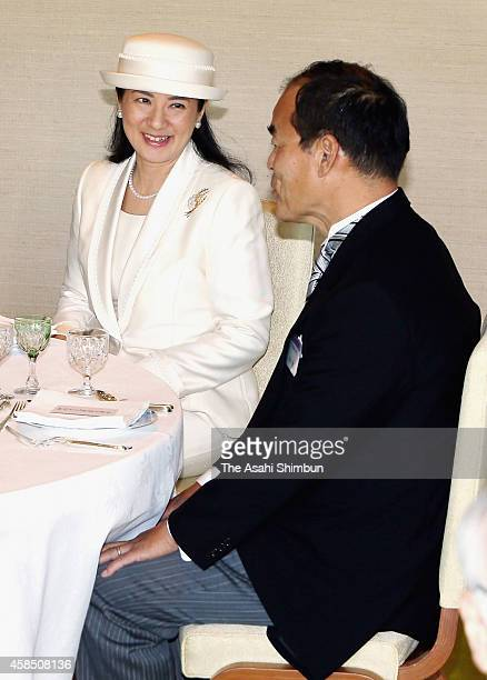 Crown Princess Masako speaks to the UC Santa Barbara scientist and the Order of Culture recipient Shuji Nakamura during a tea party hosted by Emperor...