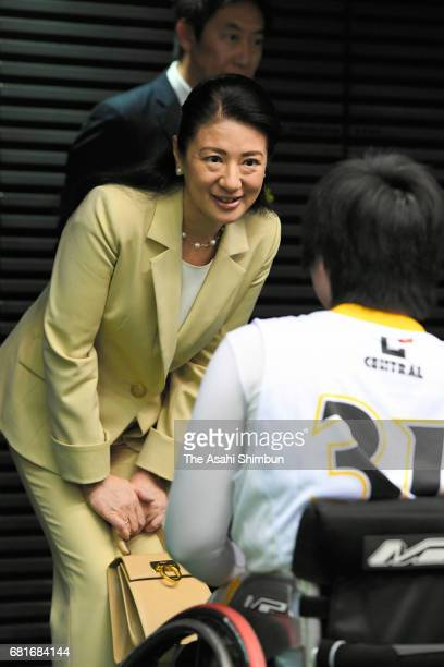 Crown Princess Masako talks with players at a wheelchair basketball match at the Tokyo Metropolitan Gymnasium on May 5 2017 in Tokyo Japan