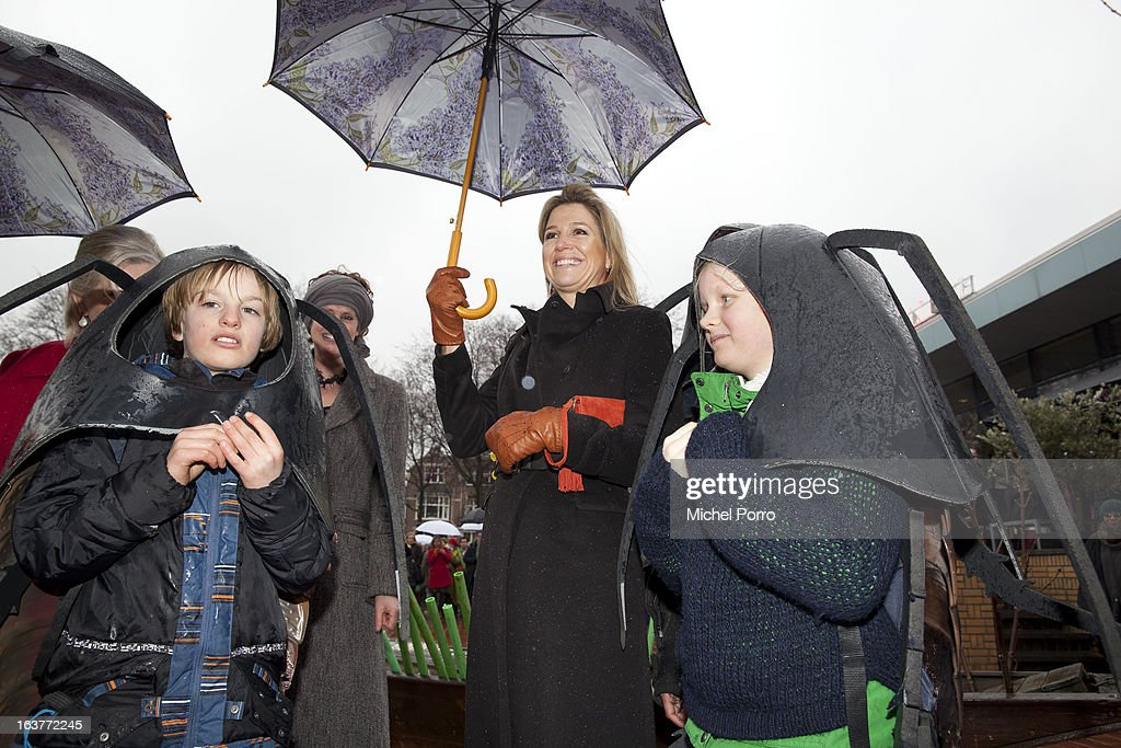 Crown Princess Maxima of The Netherlands meets children dressed as roaches during the opening of the 'Yes Naturally' art manifestation on March 15, 2013 in The Hague, Netherlands.