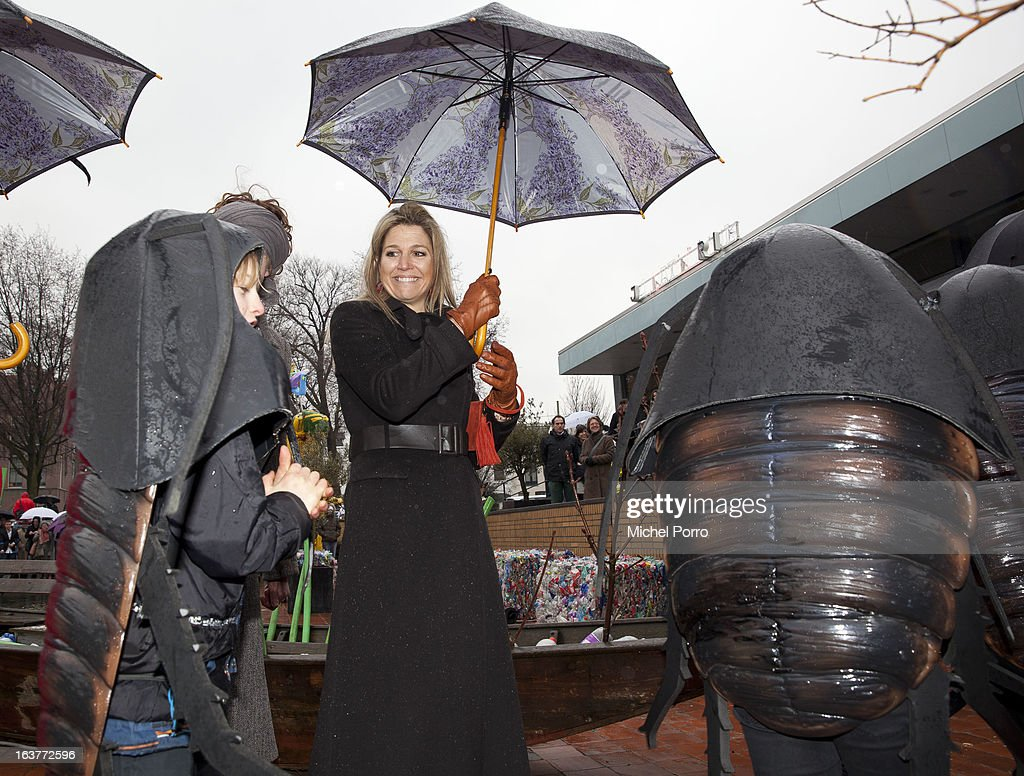 Crown Princess Maxima of The Netherlands meets with children dressed as roaches during opening the 'Yes Naturally' art manifestation on March 15, 2013 in The Hague, Netherlands.
