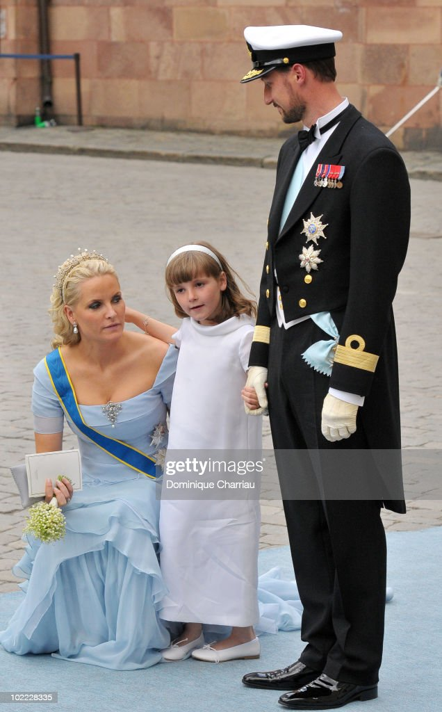 Crown Princess Mette Marit of Norway, Crown Prince Haakon of Norway and daughter Princess Ingrid-Alexandra attend the wedding of Crown Princess Victoria of Sweden and Daniel Westling on June 19, 2010 in Stockholm, Sweden.