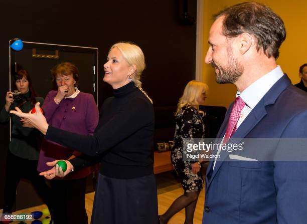 Crown Princess Mette Marit of Norway juggles whilst watched by her husband Crown Prince Haakon of Norway and the Mayor of Oslo Marianne Borgen during...