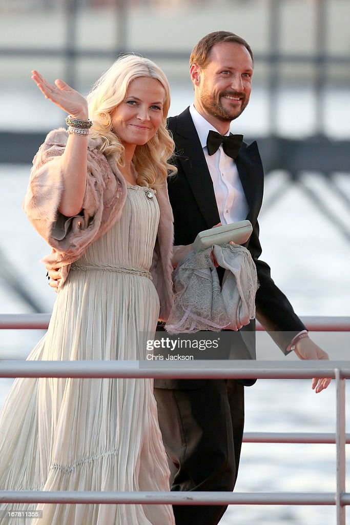 Crown Princess Mette-Marit of Norway and Crown Prince Haakon arrive at the Muziekbouw following the water pageant after the abdication of Queen Beatrix of the Netherlands and the Inauguration of King Willem Alexander of the Netherlands on April 30, 2013 in Amsterdam, Netherlands.