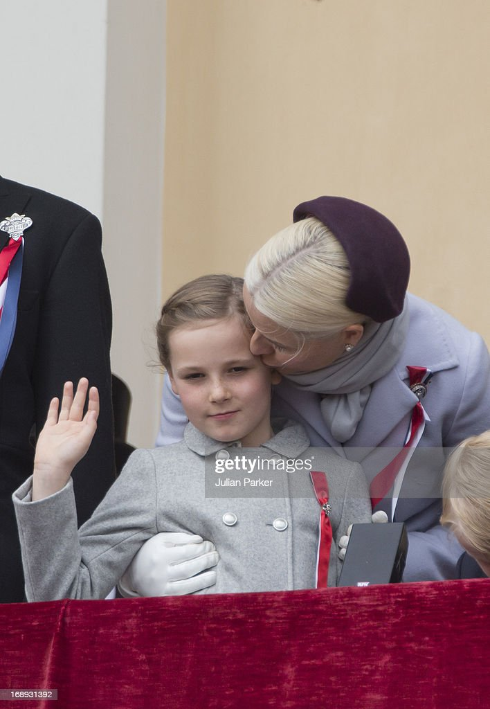 Crown Princess Mette-Marit of Norway, and Princess Ingrid Alexandra, watch the annual Norwegian National Day parade from the balcony of The Royal Palace in Oslo on May 17, 2013 in Oslo, Norway.