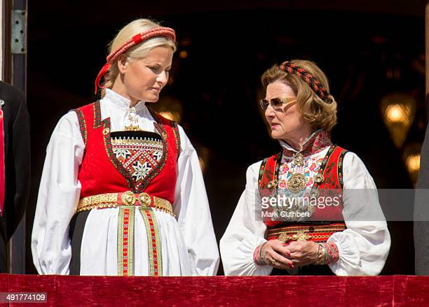 Crown Princess MetteMarit of Norway and Queen Sonja of Norway watch the National Day Childrens Parade from the Royal Palace on May 17 2014 in Oslo...
