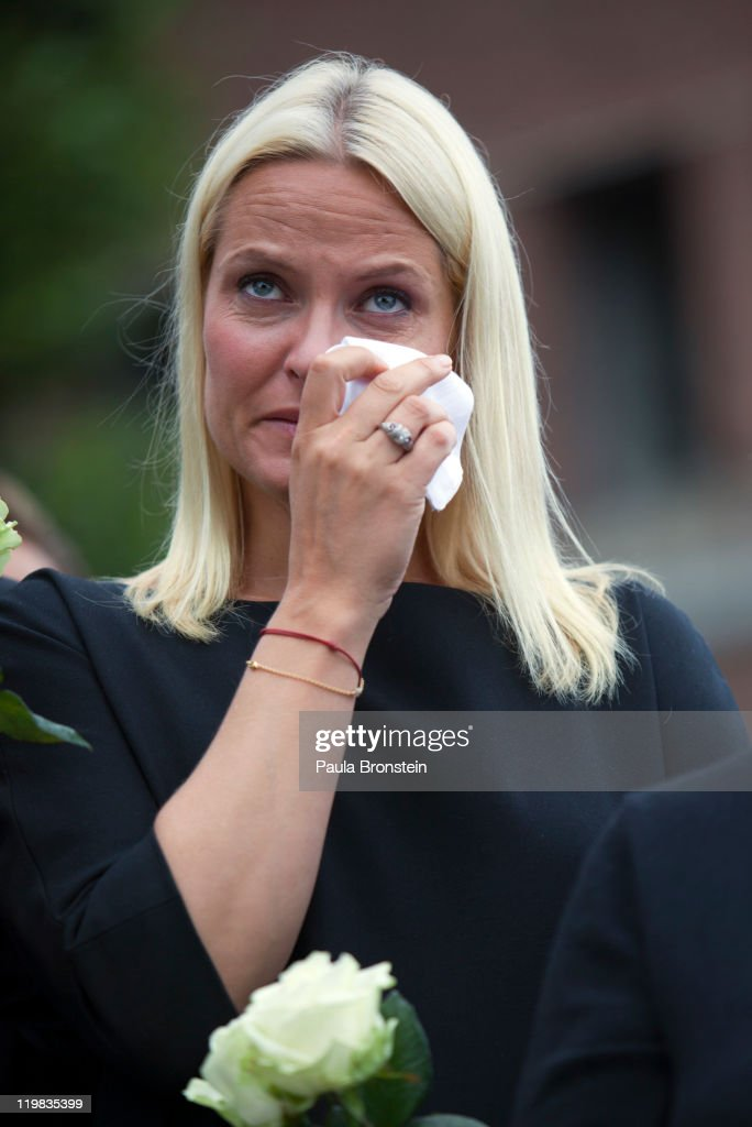 Crown Princess Mette-Marit of Norway cries as thousands of people gather at a memorial vigil following Friday's twin extremist attacks on July 25 ,2011 in Oslo, Norway. Anders Behring Breivik, 32, claimed that he has 'two more cells' working with him as he appeared in court today following a bomb blast at a government building in Oslo and a shooting massacre on nearby Utoya Island that killed at least 76 people in all. The death toll was originally reported as 93. Breivik has been detained for eight weeks, four of which in full isolation.