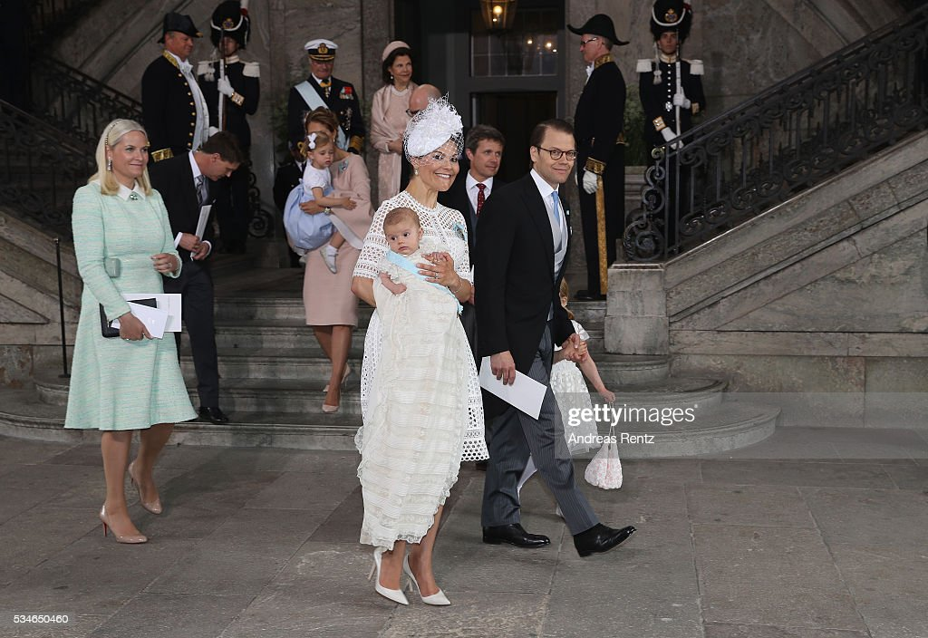 Crown Princess Mette-Marit of Norway, Crown Princess Victoria of Sweden holds Prince Oscar, Duke of Skane and Prince Daniel, Duke of Vastergotland with Princess Estelle of Sweden are seen at Royal Palace of Stockholm for the Christening of Prince Oscar of Sweden on May 27, 2016 in Stockholm, Sweden.