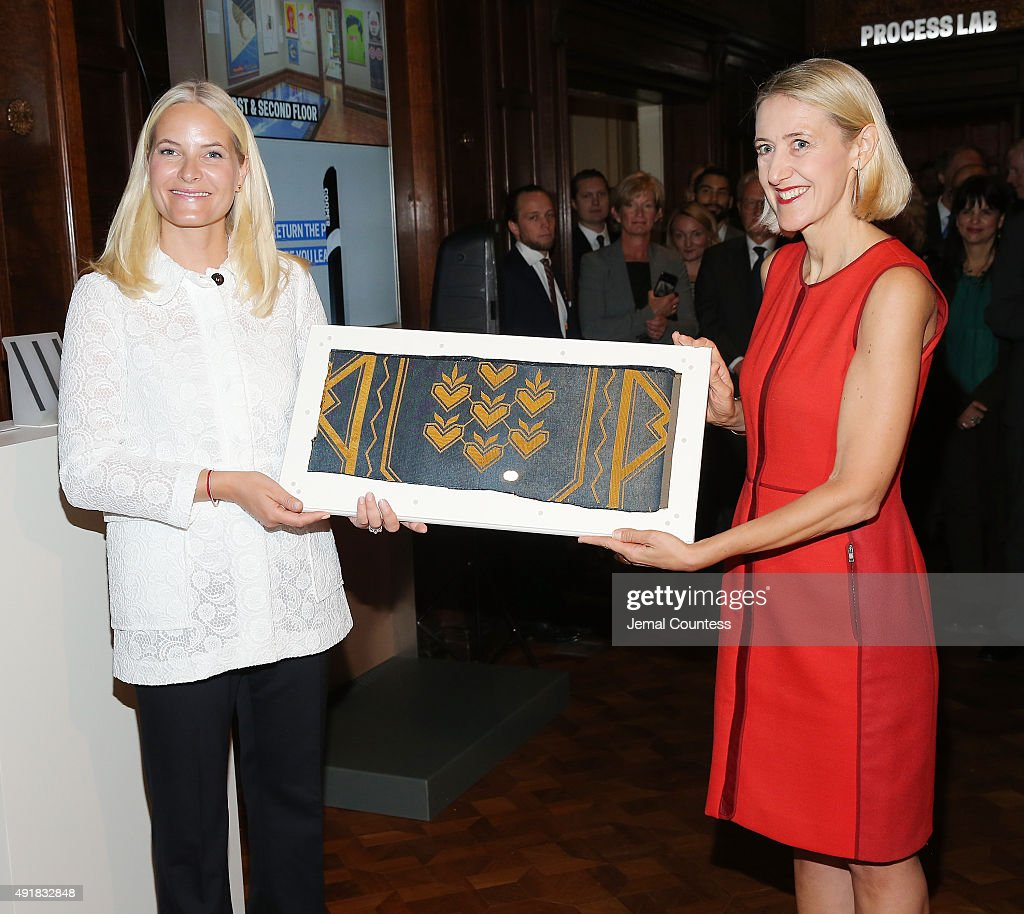 Crown Princess Mette-Marit of Norway presents a Norwegian textile that was orginally donated to the United Nations to Director of the Cooper Hewitt, Smithsonian Design Museum Caroline Baumann at Cooper Hewitt, Smithsonian Design Museum on October 8, 2015 in New York City. The Norwegian textile was the original wallpaper from the United Nations Security Chamber and was originally donated to the United Nations in 1952.