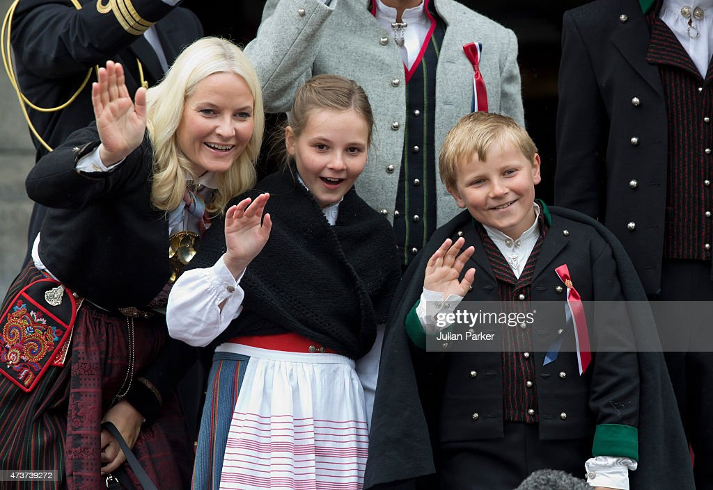 Crown Princess Mette-Marit of Norway, with Princess Ingrid Alexandra, and Prince Sverre Magnus, watch the traditional morning children's parade, at their home, Skaugum, in Asker, near Oslo, on Norway's National Day, on May 17, 2015 in Oslo, Norway.