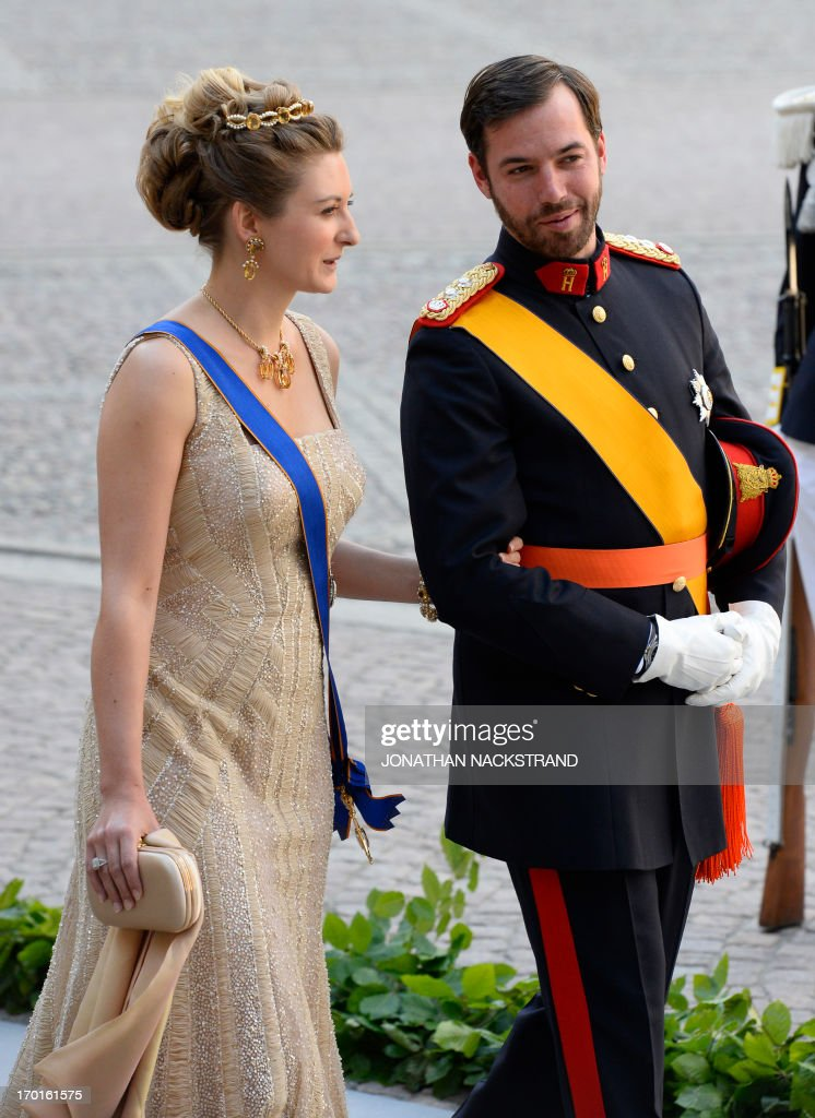 Crown Princess Stephanie of Luxembourg (L) and Prince Guillaume of Luxembourg arrive on June 8, 2013 to the Royal chapel for Princess Madeleine of Sweden and Christopher O'Neill 's wedding ceremony at the Royal castle in Stockholm, June 8, 2013.