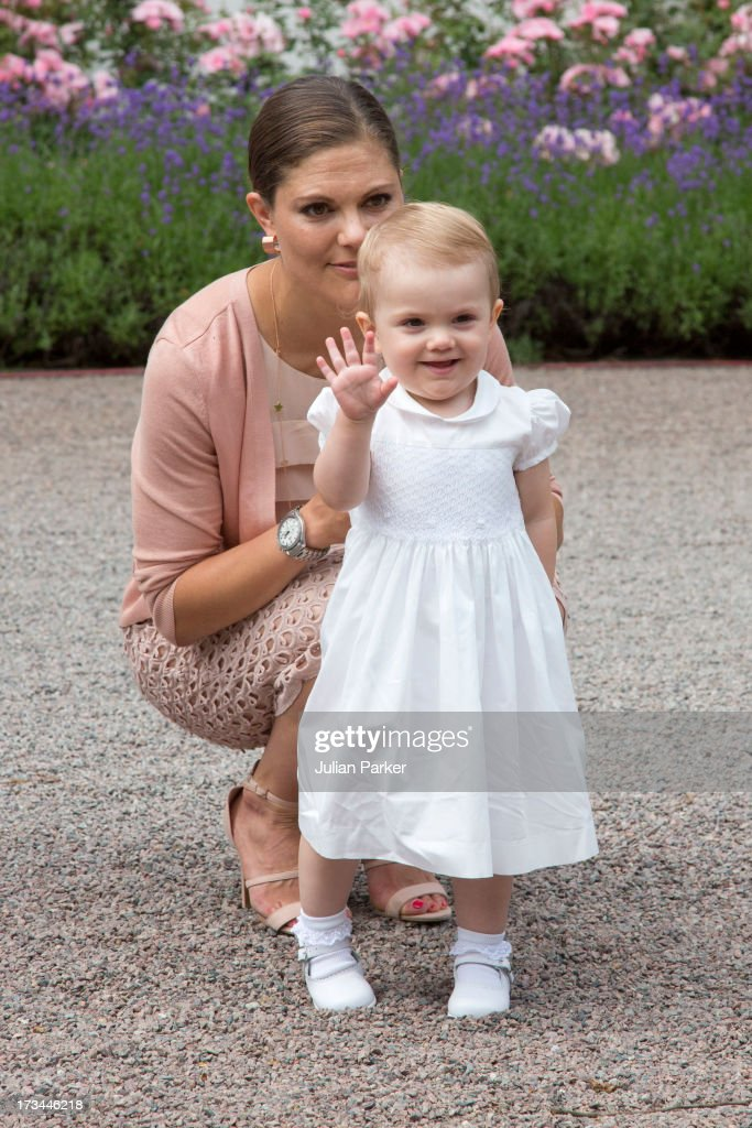 Crown Princess Victoria, and her daughter <a gi-track='captionPersonalityLinkClicked' href=/galleries/search?phrase=Princess+Estelle&family=editorial&specificpeople=8948207 ng-click='$event.stopPropagation()'>Princess Estelle</a> of Sweden, attend the Victoria Day celebrations on the Crown Princess's 36th Birthday at Solliden on July 14, 2013 in Borgholm, Sweden.