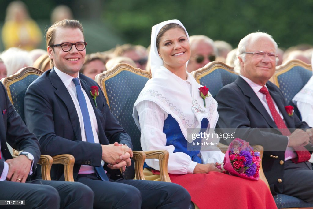 Crown Princess Victoria, and Prince Daniel of Sweden, and King Carl Gustaf of Sweden ( R ) attend The Victoria Day Concert in Borgholm, on the Crown Princess's 36th Birthday on July 14, 2013 in Borgholm, Sweden.
