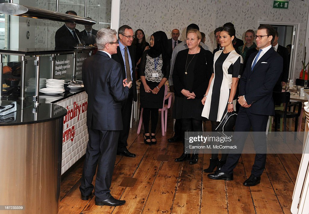 Crown Princess Victoria (2nd R) and Prince Daniel of Sweden (R) at Hackney Community College during an official visit to London on November 7, 2013 in London, England.
