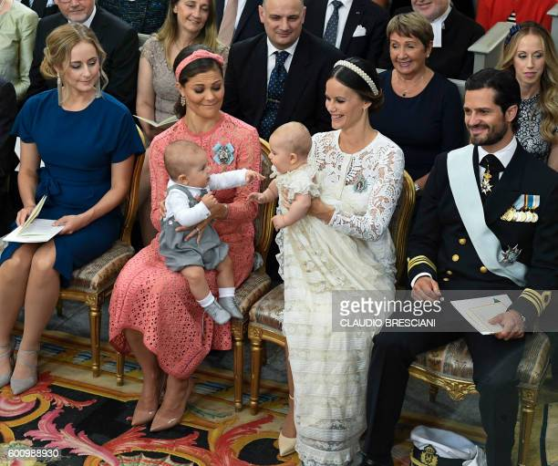 Crown Princess Victoria and Princess Sofia hold their sons Princes Oscar and Alexander at Palace Chapel in Drottningholm Palace in Stockholm during...