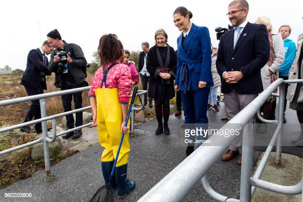 Crown Princess Victoria at the pier outside the Marine Pedagogical Learning Center where she iswelcomed by a student on October 11 2017 in Malmo...