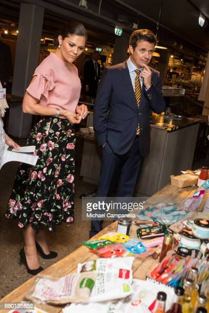 Crown Princess Victoria of Sweden and Crown Prince Frederik of Denmark are seen visting Paradiset an organic grocery store on May 30 2017 in...