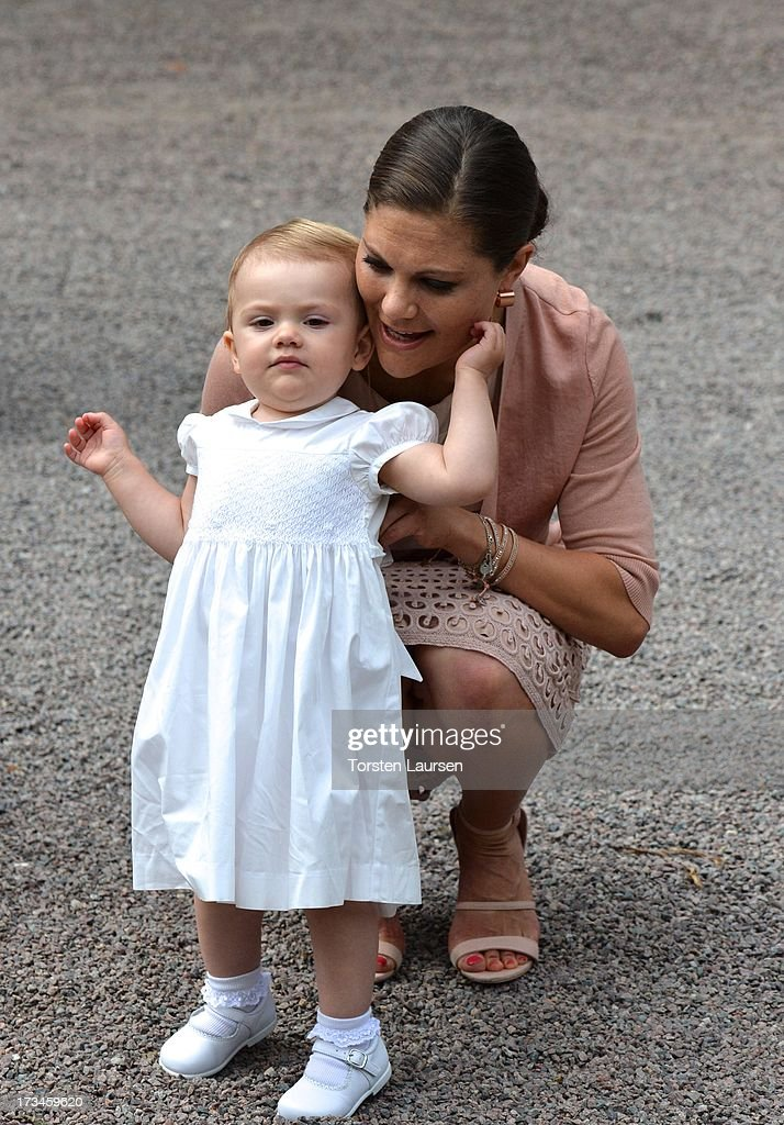 <a gi-track='captionPersonalityLinkClicked' href=/galleries/search?phrase=Crown+Princess+Victoria+of+Sweden&family=editorial&specificpeople=160266 ng-click='$event.stopPropagation()'>Crown Princess Victoria of Sweden</a> and daughter <a gi-track='captionPersonalityLinkClicked' href=/galleries/search?phrase=Princess+Estelle&family=editorial&specificpeople=8948207 ng-click='$event.stopPropagation()'>Princess Estelle</a> of Sweden attend Victoria Day celebrations at Solliden Castle on July 14, 2013 in Borgholm, Sweden.