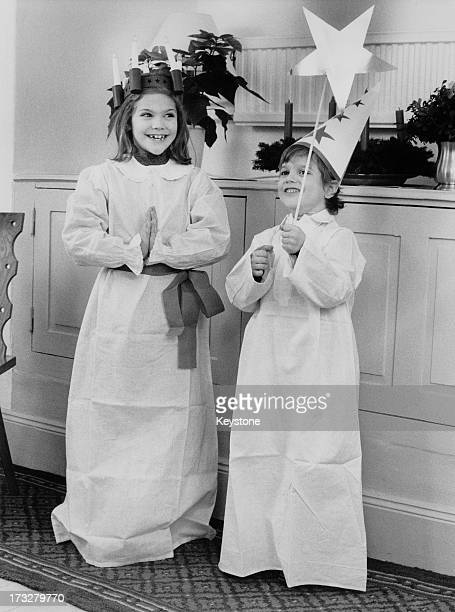 Crown Princess Victoria of Sweden and her brother Prince Carl Philip of Sweden pose in costumes for the camera 1984