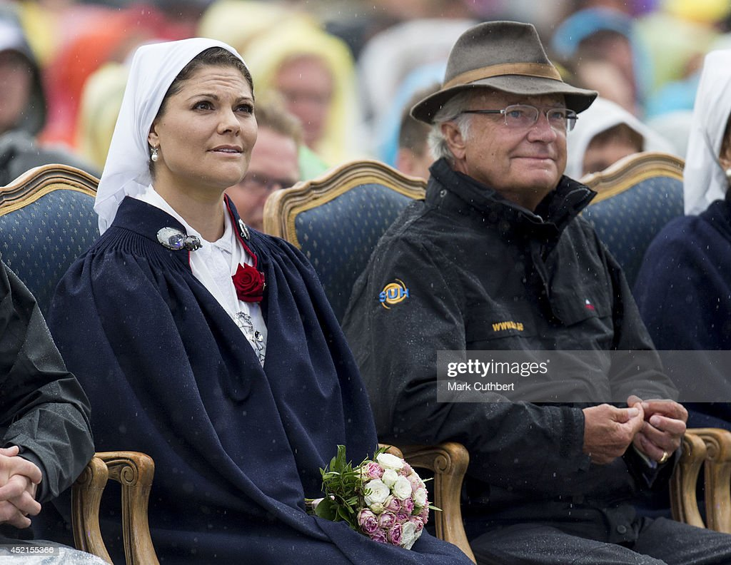 Crown Princess Victoria of Sweden and King Carl Gustaf XVI of Sweden attend a concert to celebrate her 37th birthday at Borgholm on July 14, 2014 in Oland, Sweden.