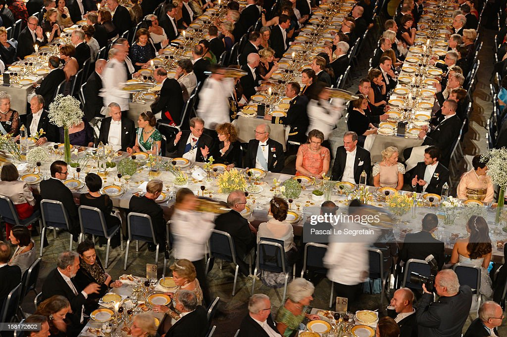 Crown Princess Victoria of Sweden (5th L) and King Carl XVI Gustaf of Sweden (6th R) attend the Nobel Banquet at Town Hall on December 10, 2012 in Stockholm, Sweden.