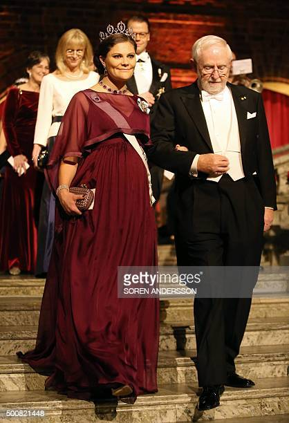 Crown Princess Victoria of Sweden and Nobel Chemistry Prize 2015 cowinner Canadian Arthur B McDonald arrive for the 2015 Nobel Banquet at the...