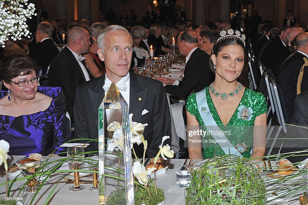Crown Princess Victoria of Sweden (R) and Nobel Prize in Chemistry laureate Professor Brian K. Kobilka of the USA (C) attend the Nobel Banquet at Town Hall on December 10, 2012 in Stockholm, Sweden.