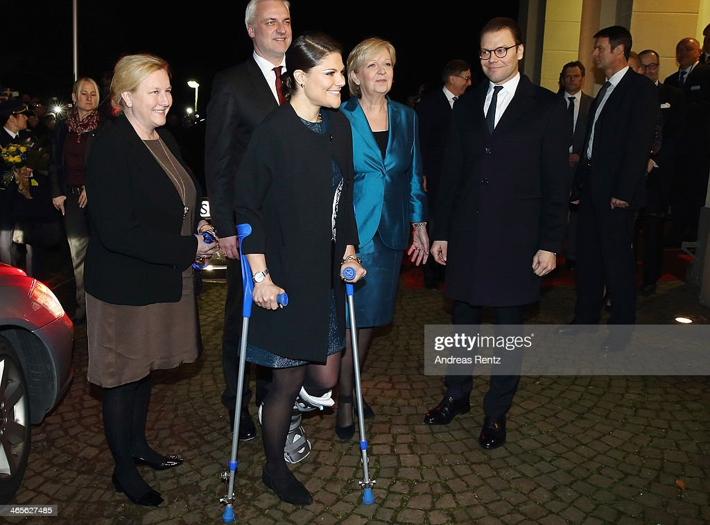 Crown Princess Victoria of Sweden (C) and Prince Daniel of Sweden (R) arrive for a dinner with Hannelore Kraft (L), Governor of North Rhine-Westphalia during their visit to North Rhine-Westphalia at Castle of Eller on January 28, 2014 in Dusseldorf, Germany.