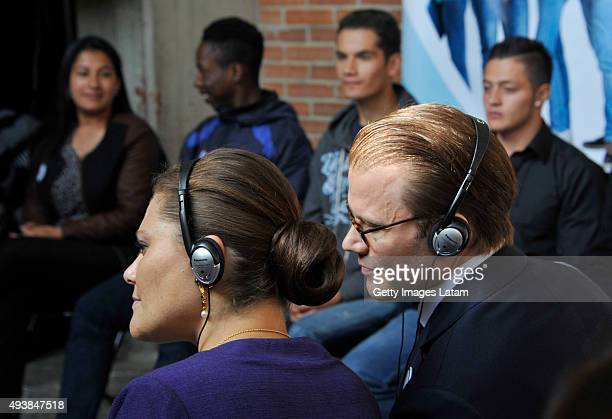 Crown Princess Victoria of Sweden and Prince Daniel of Sweden listen a group of youngsters during a visit to the enterprise driven project 'Ruta...