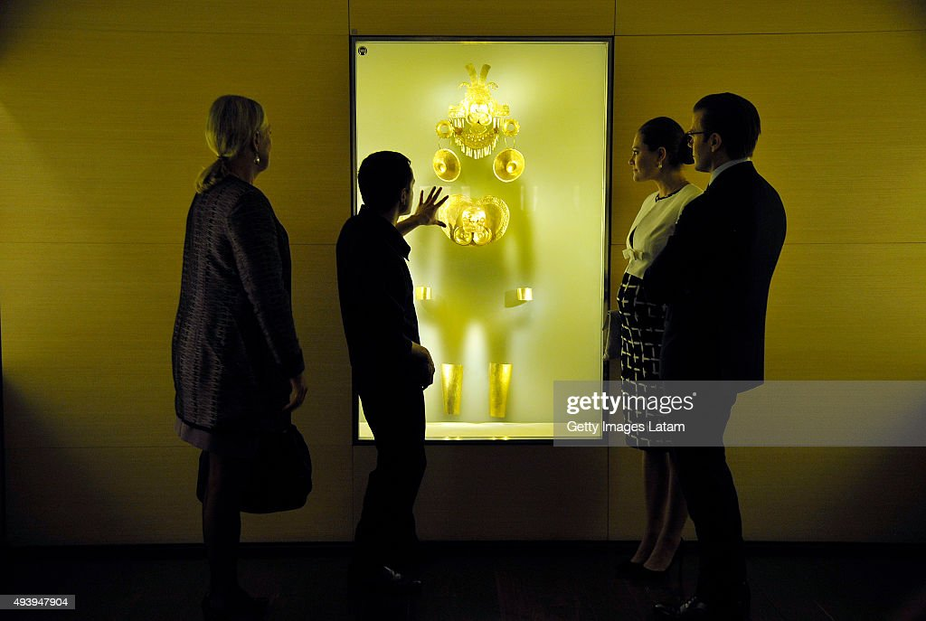 Crown Princess Victoria of Sweden and Prince Daniel of Sweden listen to the explanation of a guide during a visit to the Gold Museum on October 23, 2015 in Bogota, Colombia.