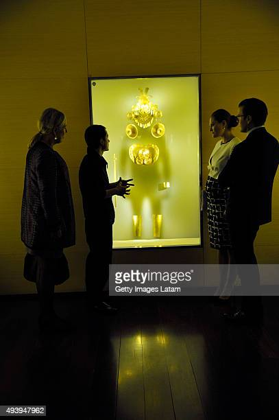 Crown Princess Victoria of Sweden and Prince Daniel of Sweden listen to the explanation of a guide during a visit to the Gold Museum on October 23...
