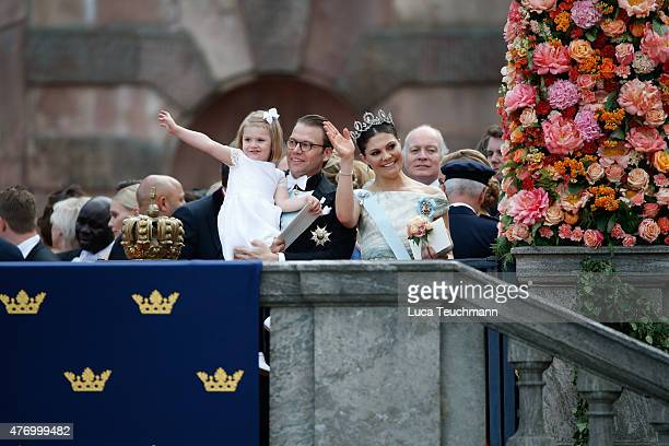 Crown Princess Victoria of Sweden and Prince Daniel with Princess Estelle greet the crowds after departing the Royal Palace Chapel on June 13 2015 in...