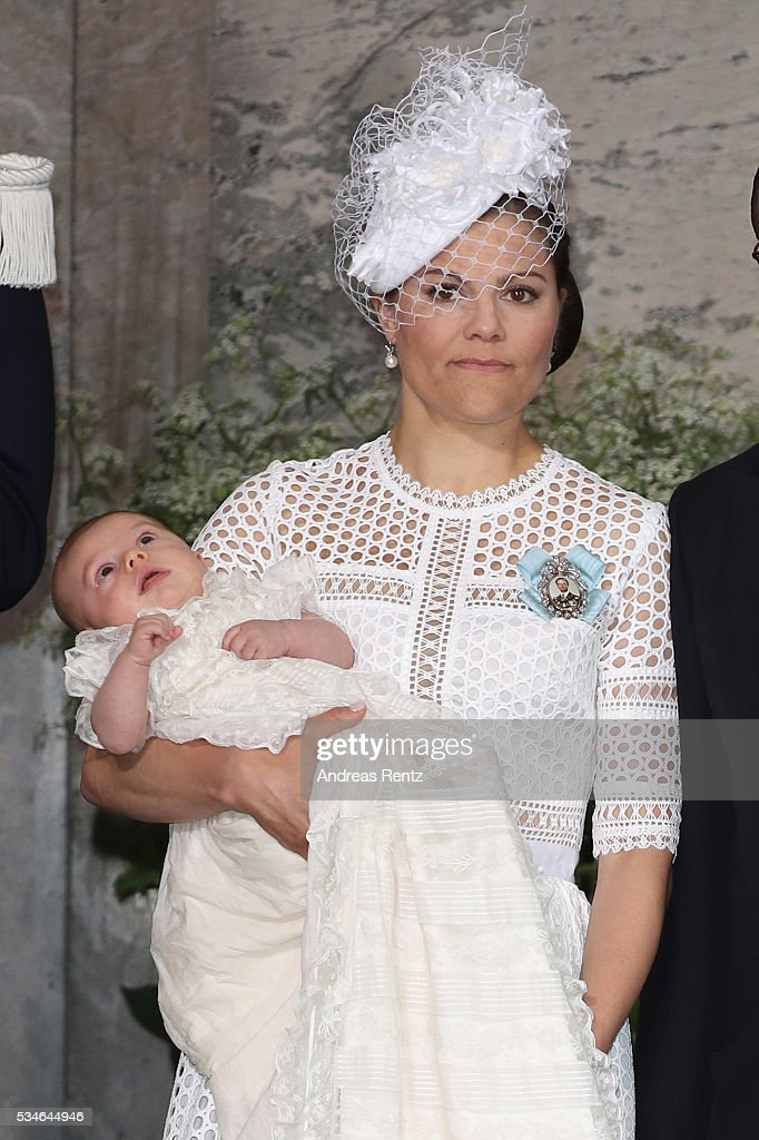 <a gi-track='captionPersonalityLinkClicked' href=/galleries/search?phrase=Crown+Princess+Victoria+of+Sweden&family=editorial&specificpeople=160266 ng-click='$event.stopPropagation()'>Crown Princess Victoria of Sweden</a> and Prince Oscar of Sweden are seen at Drottningholm Palace for the Christening of Prince Oscar of Sweden on May 27, 2016 in Stockholm, Sweden.