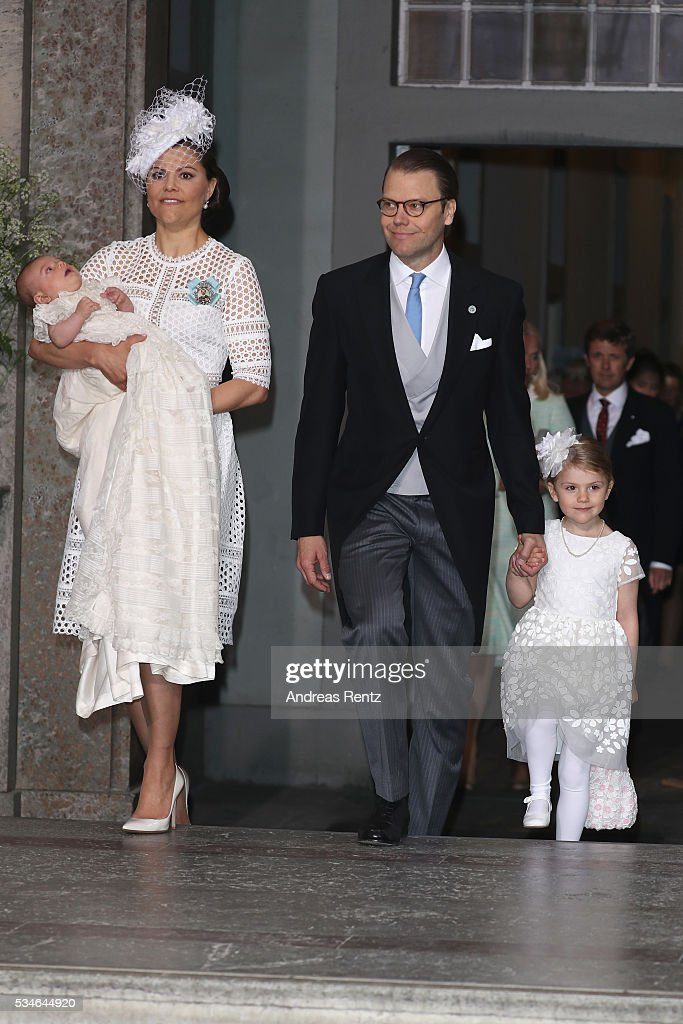 <a gi-track='captionPersonalityLinkClicked' href=/galleries/search?phrase=Crown+Princess+Victoria+of+Sweden&family=editorial&specificpeople=160266 ng-click='$event.stopPropagation()'>Crown Princess Victoria of Sweden</a> and Prince Oscar of Sweden, Prince Daniel of Sweden and <a gi-track='captionPersonalityLinkClicked' href=/galleries/search?phrase=Princess+Estelle&family=editorial&specificpeople=8948207 ng-click='$event.stopPropagation()'>Princess Estelle</a> of Sweden are seen at Drottningholm Palace for the Christening of Prince Oscar of Sweden on May 27, 2016 in Stockholm, Sweden.