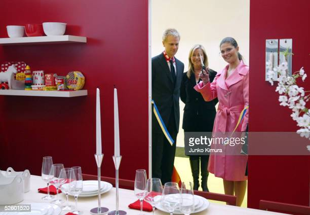 Crown Princess Victoria of Sweden cuts a ribbon during the opening ceremony of 'HOME SWEDish HOME' at Swedish Embassy in Japan on April 8 2005 in...