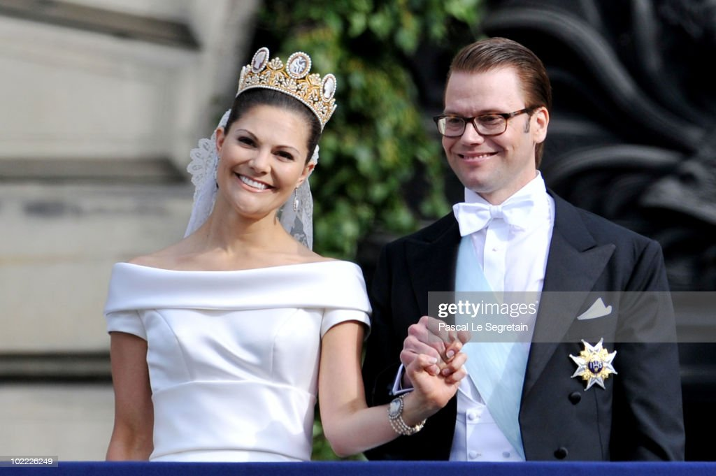<a gi-track='captionPersonalityLinkClicked' href=/galleries/search?phrase=Crown+Princess+Victoria+of+Sweden&family=editorial&specificpeople=160266 ng-click='$event.stopPropagation()'>Crown Princess Victoria of Sweden</a>, Duchess of Västergötland, and her husband Prince Daniel, Duke of Västergötland, meet the general public as they appear on the Lejonbacken Terrace after their wedding ceremony on June 19, 2010 in Stockholm, Sweden.