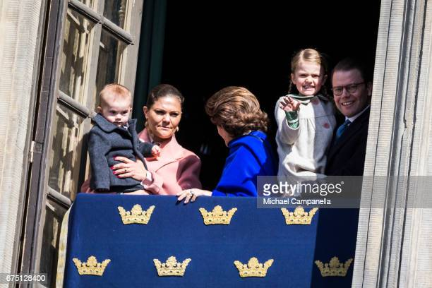 Crown Princess Victoria of Sweden holding Prince Oscar of Sweden Queen Silvia of Sweden and Prince Daniel of Sweden holding Princess Estelle of...
