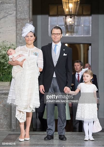 Crown Princess Victoria of Sweden holds her son Prince Oscar as they arrive with Prince Daniel of Sweden and Princess Estelle of Sweden to his...