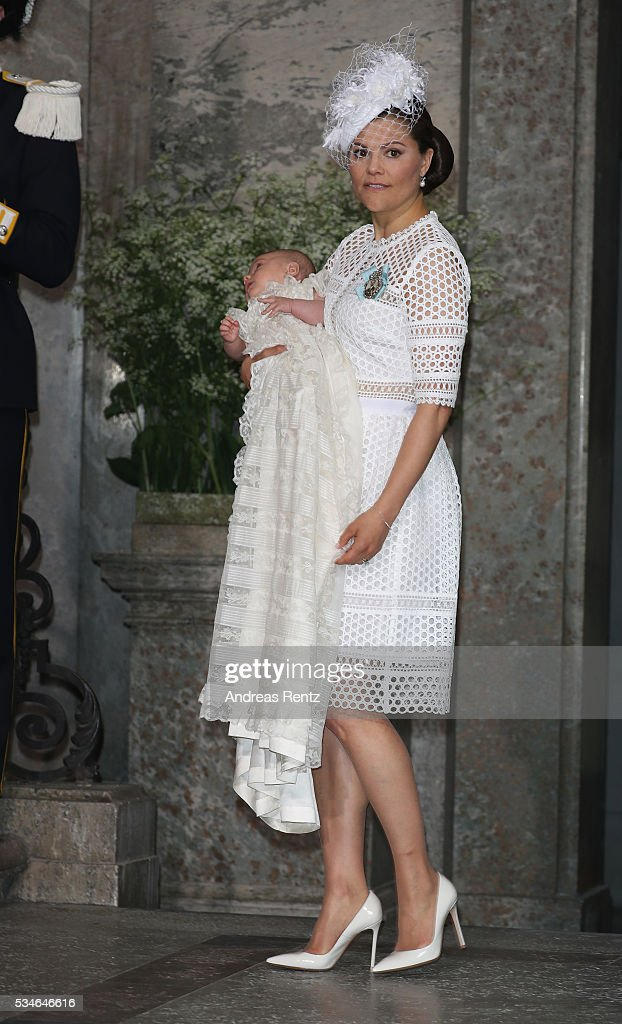 Crown Princess Victoria of Sweden holds Prince Oscar Duke of Skane upon their arrival at Royal Palace of Stockholm for the Christening of Prince Oscar of Sweden on May 27, 2016 in Stockholm, Sweden.