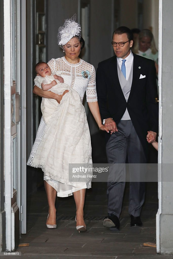Crown Princess Victoria of Sweden holds Prince Oscar Duke of Skane and Prince Daniel, Duke of Vastergotland with Princess Estelle of Sweden are seen at Royal Palace of Stockholm for the Christening of Prince Oscar of Sweden on May 27, 2016 in Stockholm, Sweden.