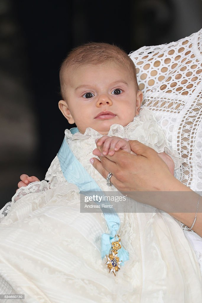Crown Princess Victoria of Sweden holds Prince Oscar, Duke of Skane after the ceremony at Royal Palace of Stockholm for the Christening of Prince Oscar of Sweden on May 27, 2016 in Stockholm, Sweden.