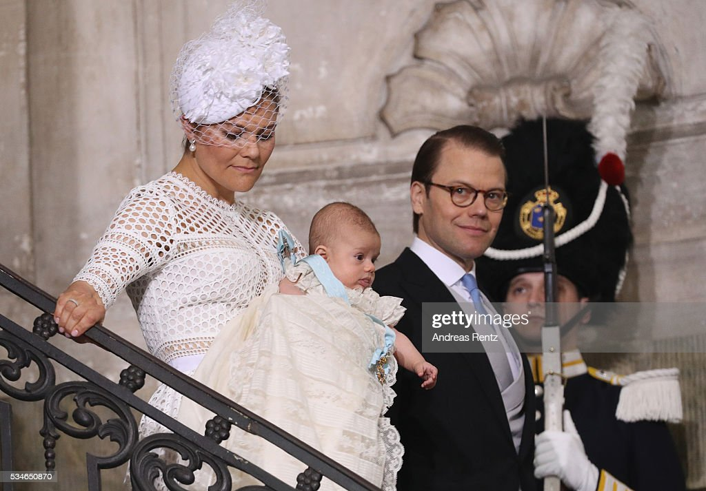 Crown Princess Victoria of Sweden holds Prince Oscar, Duke of Skane and Prince Daniel, Duke of Vastergotland with Princess Estelle of Sweden are seen after the ceremony at Royal Palace of Stockholm for the Christening of Prince Oscar of Sweden on May 27, 2016 in Stockholm, Sweden.