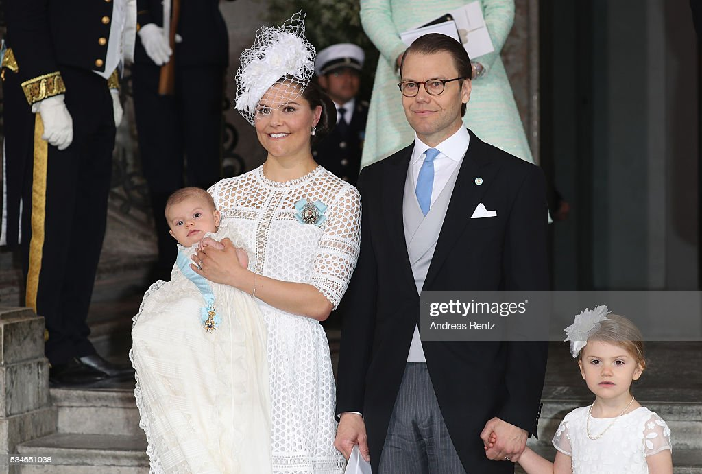 <a gi-track='captionPersonalityLinkClicked' href=/galleries/search?phrase=Crown+Princess+Victoria+of+Sweden&family=editorial&specificpeople=160266 ng-click='$event.stopPropagation()'>Crown Princess Victoria of Sweden</a> holds Prince Oscar, Duke of Skane and Prince Daniel, Duke of Vastergotland with <a gi-track='captionPersonalityLinkClicked' href=/galleries/search?phrase=Princess+Estelle&family=editorial&specificpeople=8948207 ng-click='$event.stopPropagation()'>Princess Estelle</a> of Sweden are seen after the ceremony at Royal Palace of Stockholm for the Christening of Prince Oscar of Sweden on May 27, 2016 in Stockholm, Sweden.